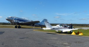 A couple of pioneers: Steve Daniel's Pioneer 300 parked next to one of aviation's great pioneering aeroplanes: a DC3.
