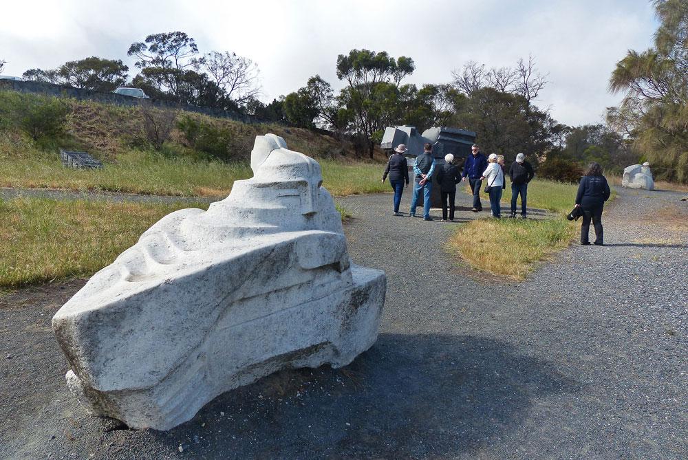 People walking around rock sculptures